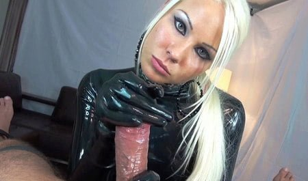 Blonde in latex costume jerks off a bound peasant